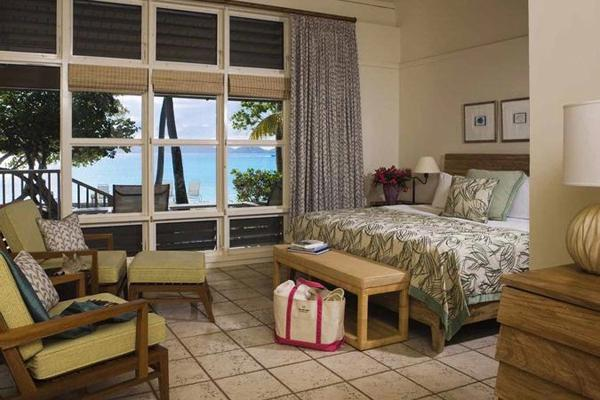 "<div class=""caption-credit""> Photo by: Rosewood Hotels</div><div class=""caption-title"">3. Premium Ocean View Room At Caneel Bay, A Rosewood Resort, In St. John, U.S.V.I.</div><p>   While technically not a suite, these ultra-private cottage-like accommodations are so spacious and set in a way that they feel so remote, they needed to make the list. Old-school levered windows and overhead fans keep the oceanview rooms breezy and comfortable, as do the rattan furnishings. Large stone patios are shaded by lush tropical foliage to ensure the ultimate privacy and feature chaise loungers that look out onto the sea. For more info, visit <a rel=""nofollow"" href=""http://www.bridalguide.com/planning/wedding-reception/fall-wedding-ideas"" target="""">rosewoodhotels.com/en/caneelbay</a>. </p> <p>   <b>Related: <a rel=""nofollow"" href=""http://www.bridalguide.com/honeymoons/caribbean/caribbean-honeymoons-for-every-budget"" target="""">Caribbean Honeymoons for Every Budget</a></b> </p>"