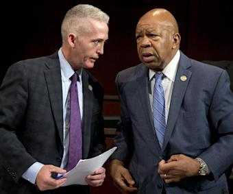 House Select Committee on Benghazi chairman Rep. Trey Gowdy, R-S.C., left, and ranking member Elijah Cummings, D-Md., talks on Capitol Hill in Washington, Wednesday, Sept. 17, 2014, as they leave the House Select Committee on Benghazi hearing on the implementation of the Accountability Review Board recommendations. (AP Photo/Carolyn Kaster)