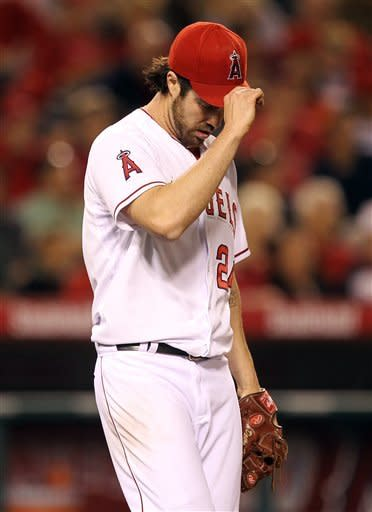 Los Angeles Angels starting pitcher Dan Haren hangs his head after giving up two runs to the Oakland Athletics during the fifth inning of a baseball game in Anaheim, Calif., Monday, May 14, 2012. (AP Photo/Chris Carlson)