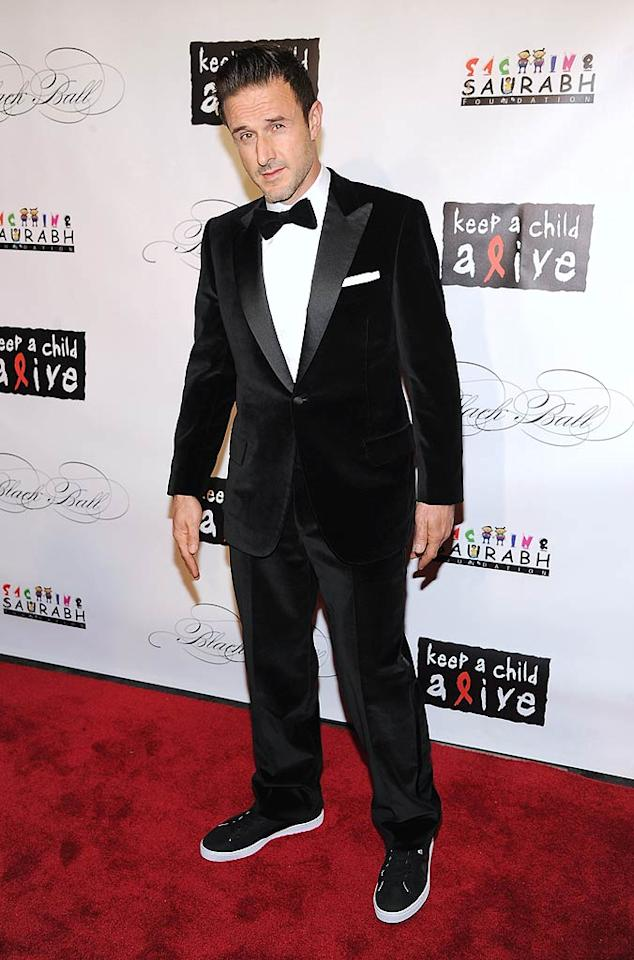 Meanwhile, David Arquette was dapper in his black velvet tux -- until you looked at his feet. (11/3/2011)
