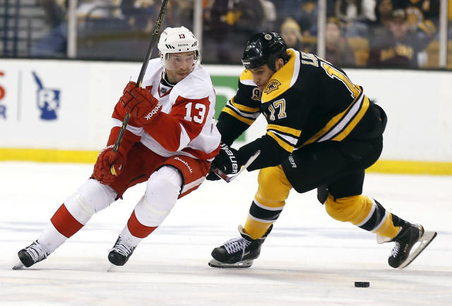 Detroit Red Wings' Pavel Datsyuk (13) tries to get around Boston Bruins' Milan Lucic (17) during the second period of Game 2 of a first-round NHL hockey playoff series in Boston, Sunday, April 20, 2014. (AP Photo/Winslow Townson)