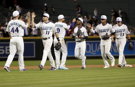 The Arizona Diamondbacks celebrate a 3-1 win in a baseball game against the San Francisco Giants on Thursday, April 19, 2018, in Phoenix. (AP Photo/Matt York)