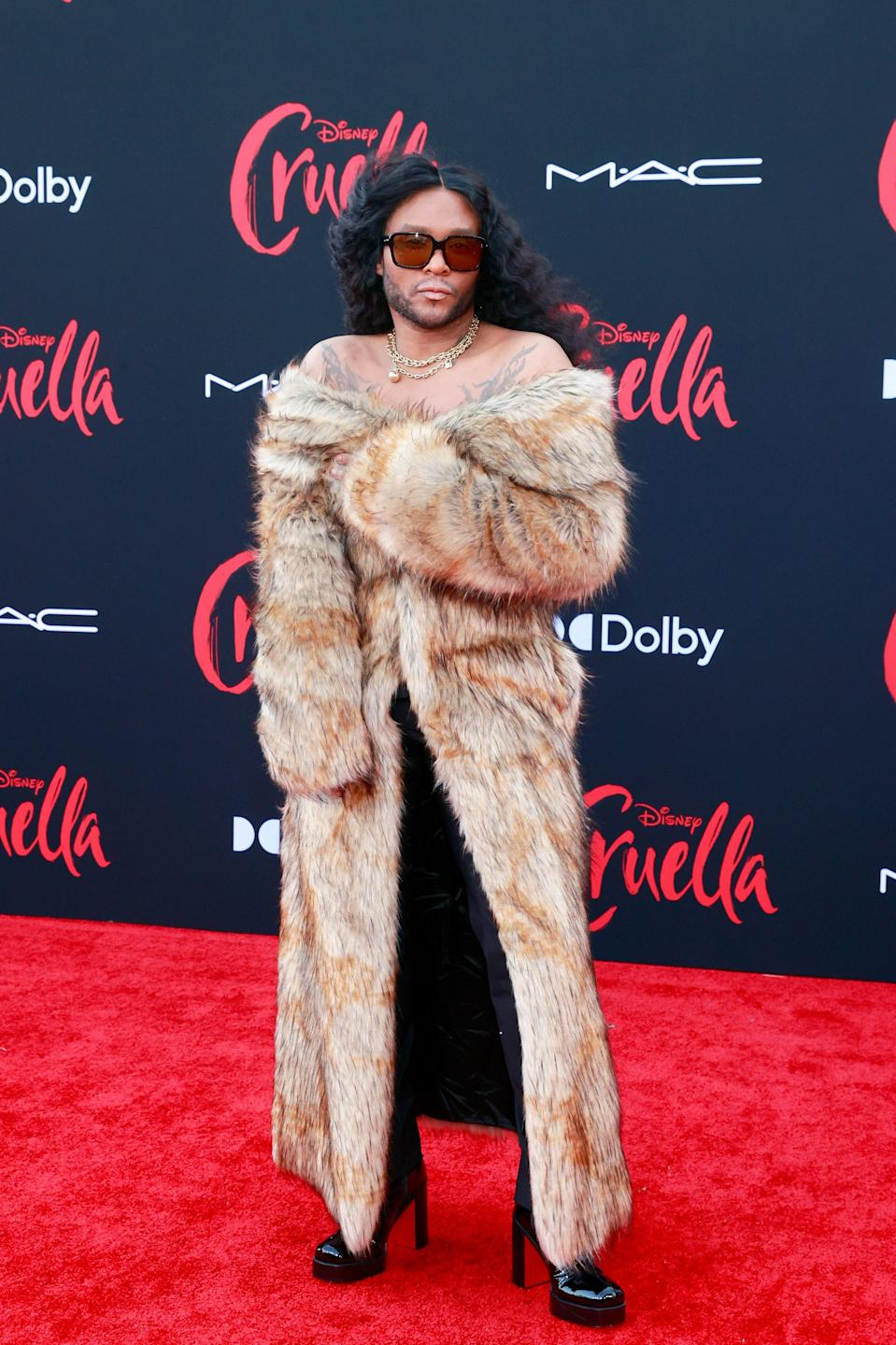 Stylist Law Roach came dressed to the nines, wearing a very Cruella long fur coat as a dress and sky-high platform heels.