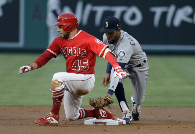 Los Angeles Angels' David Fletcher, left, slides safely into second base with a double past the tag attempt by Seattle Mariners shortstop J.P. Crawford during the first inning of a baseball game Friday, July 12, 2019, in Anaheim, Calif. (AP Photo/Marcio Jose Sanchez)