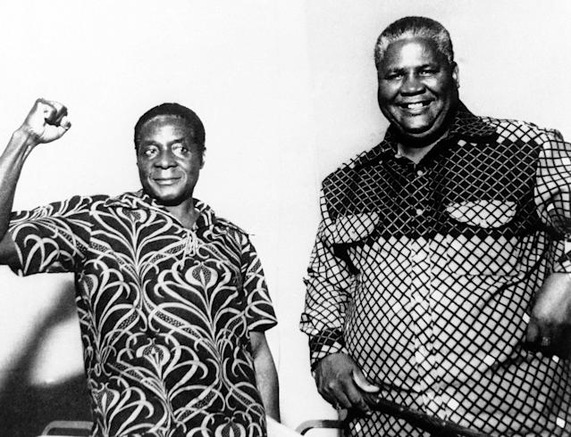<p>Leaders of African National Congress of Zimbabwe (Rhodesia) Robert Mugabe, left, and Joshua Nkomo were in cheerful mood at a joint press conference they gave in Dar Ea Salaam, Tanzania, on Oct. 9, 1976. (Photo: AP) </p>