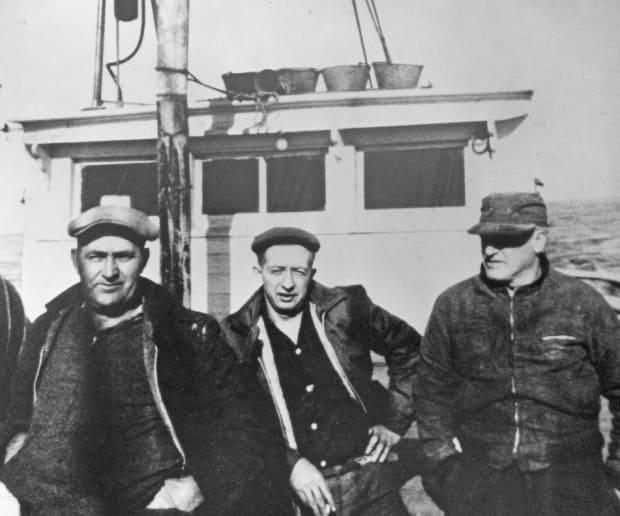 Captain Harvey Banfield, left, and his crew, who delivered the Dunton to her new owners at Mystic in 1963.