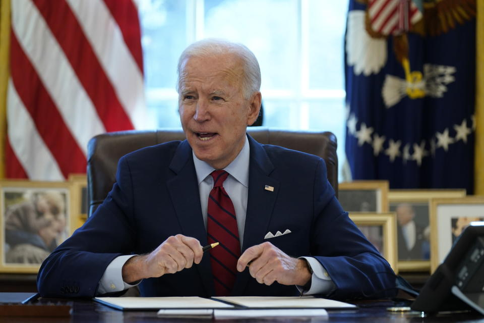 President Joe Biden signs a series of executive orders on health care, in the Oval Office of the White House, Thursday, Jan. 28, 2021, in Washington. The Democratic push to raise the minimum wage to $15 an hour has emerged as an early flash point in the push for a $1.9 trillion COVID relief package, providing an early test of President Joe Biden's ability to bridge Washington's partisan divide in pursuing his first major legislative victory. (AP Photo/Evan Vucci)