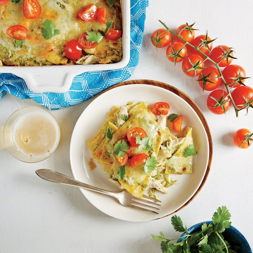 """<p>This creamy chicken enchilada casserole is a cinch to assemble in advance and easy to freeze—just cover one of the pans with foil. If you plan to serve a crowd, you can bake the chicken enchilada casserole in one (13- x 9-inch) baking dish. The chicken stays moist throughout baking and reheating, thanks to a gentle poach and a rich verde sauce. Be sure to include your fresh cilantro stems in the sauce, they have tons of flavor!</p> <p><a href=""""https://www.myrecipes.com/recipe/chicken-enchilada-casserole-5"""">Chicken Enchilada Casserole Recipe</a></p>"""