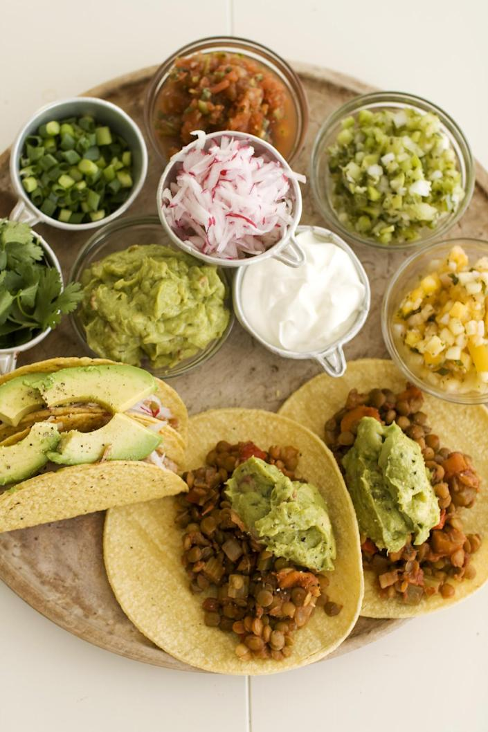 In this image taken on May 13, 2013, lentil tacos, right, and pulled pork tacos are served on a plate as seen in Concord, N.H. (AP Photo/Matthew Mead)