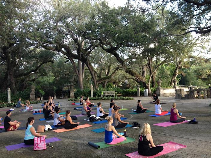 A morning yoga class at Vizcaya Museum and Gardens.