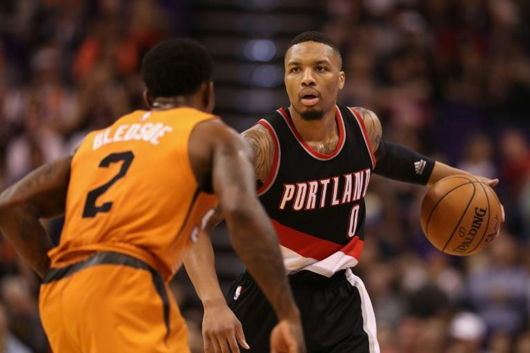 Damian Lillard (R) scored 36 points, including four free throws in the final five seconds, as the Portland Trail Blazers stunned the San Antonio Spurs 110-106