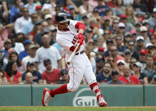 Boston Red Sox's Mookie Betts swings for a hit against the Toronto Blue Jays during the ninth inning of a baseball game Saturday, July 14, 2018, in Boston. (AP Photo/Winslow Townson)