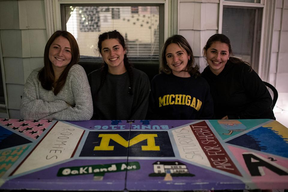 From left, U-M seniors Lena Stein, art major, Alyssa Dern, engineering major, Alana Woloshin, information science major and Amanda Kaplan, public policy major pose for a photo in the front porch of their house in Ann Arbor, Friday, Oct. 30, 2020.