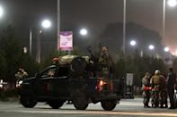 Afghan security forces stand guard near the site of a suicide attack at the entrance to the Police Academy in Kabul on August 7, 2015