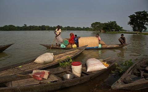 Some 4.5 million have been affected by the flooding in Assam - Credit: AP Photo/Anupam Nath