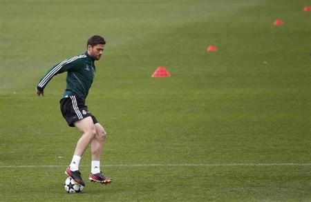 Real Madrid's Alonso controls ball during training session on eve of their Champions League semi-final second leg soccer match against Borussia Dortmund, at Valdebebas training grounds, outside Madrid