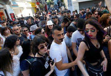 Gay pride parades sound note of resistance - and face some