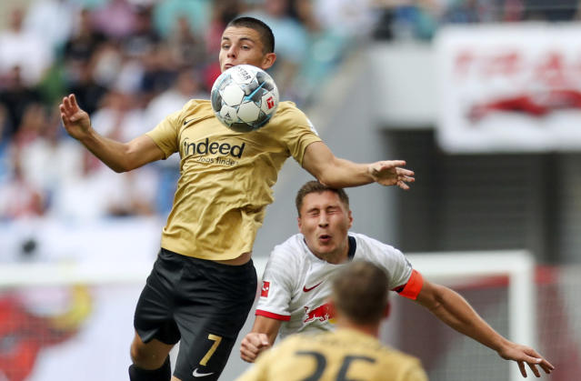 Frankfurt's Dejan Joveljic, left, jumps for a header with Leipzig's Willi Orban during the German Bundesliga soccer match between RB Leipzig and Eintracht Frankfurt in Leipzig, Germany, Sunday, Aug. 25, 2019. (Jan Woitas/dpa via AP)
