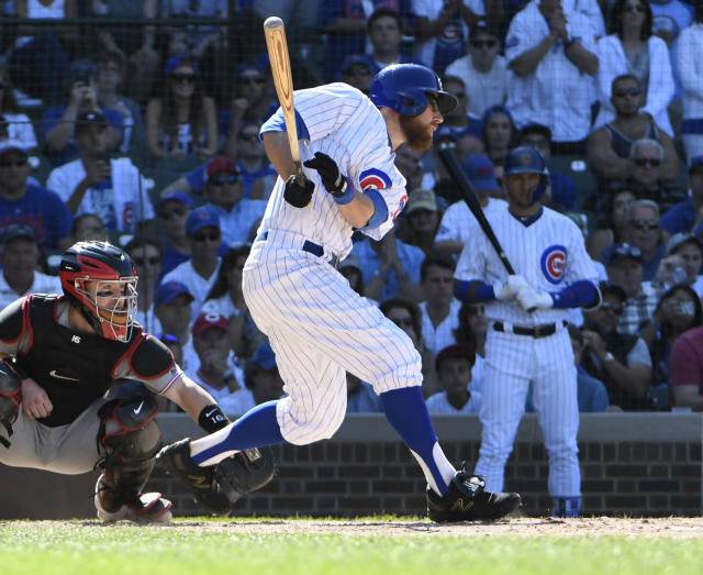 Chicago Cubs' Ben Zobrist (18) hits a two-run double against the Cincinnati Reds during the eighth inning of a baseball game Saturday, July 7, 2018, in Chicago. (AP Photo/David Banks)