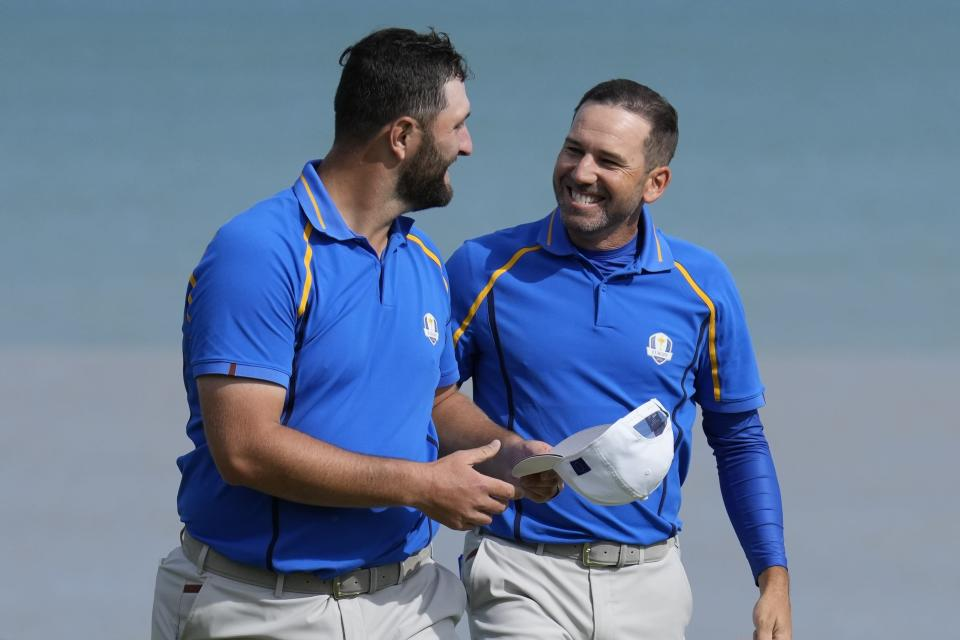 Team Europe's Jon Rahm and Team Europe's Sergio Garcia react after winning their foursome match the Ryder Cup at the Whistling Straits Golf Course Friday, Sept. 24, 2021, in Sheboygan, Wis. (AP Photo/Ashley Landis)