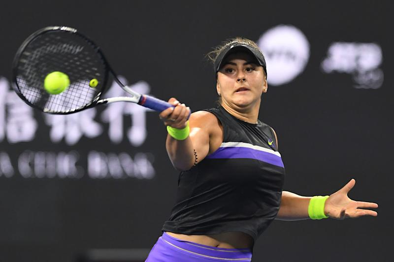 Bianca Andreescu of Canada hits a return during her women's singles third round match against Jennifer Brady of the US at the China Open tennis tournament in Beijing on October 3, 2019. (Photo by GREG BAKER / AFP) (Photo by GREG BAKER/AFP via Getty Images)