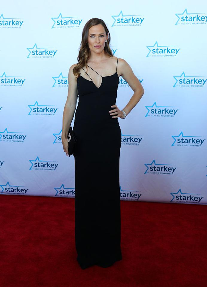 <p>The actress wore a curve-hugging black gown while walking the red carpet for a gala event benefitting the Starkey Hearing Foundation. <i>(Photo by Adam Bettcher/Getty Images for Starkey Hearing Foundation)</i></p>