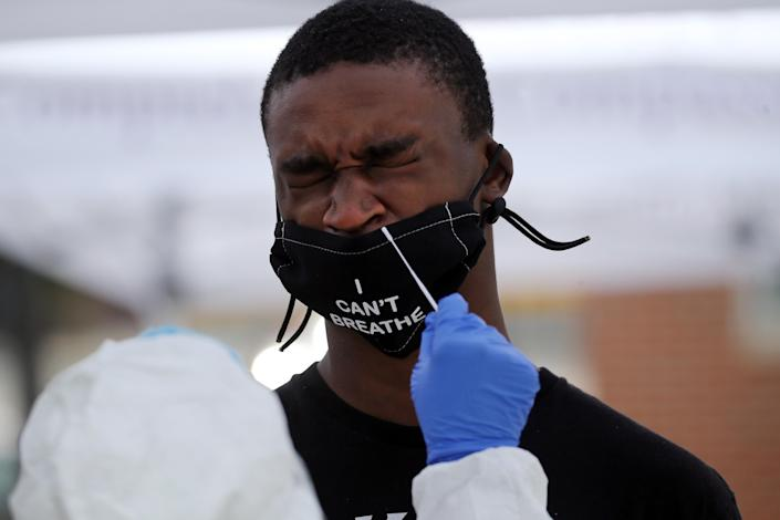 A man is tested for COVID-19 in the Roxbury neighborhood of Boston, MA on July 08, 2020. (Photo by Craig F. Walker/The Boston Globe via Getty Images)