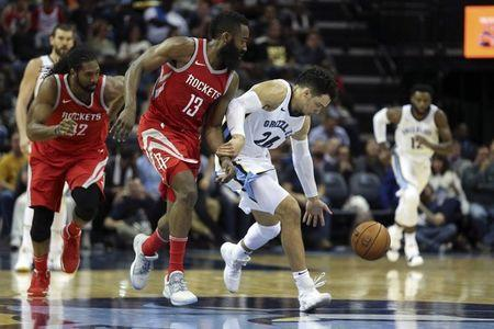 Nov 18, 2017; Memphis, TN, USA; Memphis Grizzlies guard Dillon Brooks (26) grabs the loose ball against Houston Rockets guard James Harden (13) during the third quarter at FedExForum. Mandatory Credit: Spruce Derden-USA TODAY Sports