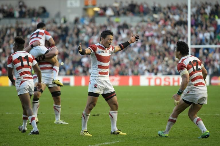 "Japan's full-back Ayumu Goromaru (centre, arms outstretched) celebrates at the final whistle after the ""Miracle of Brighton"" in 2015 where he scored 24 points in a 34-32 victory over South Africa masterminded by current England coach Eddie Jones"