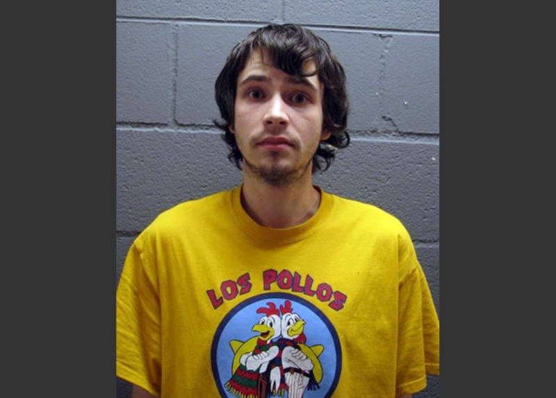 "In this undated booking photo provided by the Cook County Sheriff's Office, Daniel Kowalski, a suburban Chicago man accused of operating a methamphetamine lab, wears a t-shirt for the fictional Los Pollos Hermanos chicken restaurant depicted in ""Breaking Bad,"" a show about a methamphetamine manufacturer. Kowalski, 21, is charged with felony possession of a controlled substance, methamphetamine manufacturing materials and precursors. (AP Photo/Cook County Sheriff's Office)"