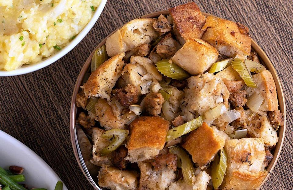 """<p>This slow cooker stuffing recipe will have your dinner guests begging to bring leftovers home with them. Just make sure they know that stuffing <a href=""""https://www.thedailymeal.com/holidays/how-long-thanksgiving-leftovers-are-safe-to-eat?referrer=yahoo&category=beauty_food&include_utm=1&utm_medium=referral&utm_source=yahoo&utm_campaign=feed"""" rel=""""nofollow noopener"""" target=""""_blank"""" data-ylk=""""slk:lasts in the fridge for only about four days"""" class=""""link rapid-noclick-resp"""">lasts in the fridge for only about four days</a>.</p> <p><a href=""""https://www.thedailymeal.com/slow-cooker-sausage-stuffing-with-sourdough?referrer=yahoo&category=beauty_food&include_utm=1&utm_medium=referral&utm_source=yahoo&utm_campaign=feed"""" rel=""""nofollow noopener"""" target=""""_blank"""" data-ylk=""""slk:For the Slow Cooker Saus'age Stuffing recipe, click here."""" class=""""link rapid-noclick-resp"""">For the Slow Cooker Saus'age Stuffing recipe, click here.</a></p>"""