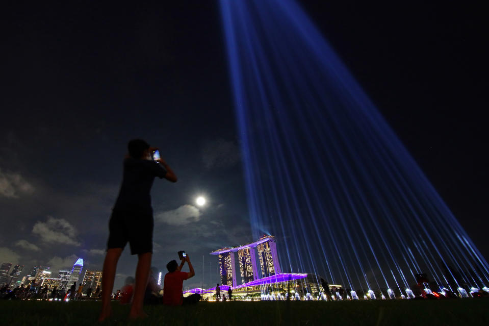 A light projection at the Marina Bay Sands in Singapore in place of fireworks for the New Year's Eve celebration.
