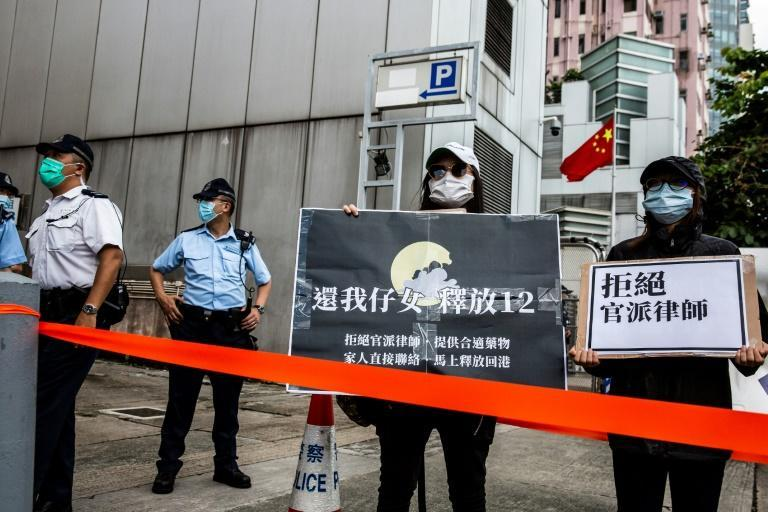 Relatives of the 12 detainees gather outside Beijing's Liaison Office in Hong Kong, to petition for their return