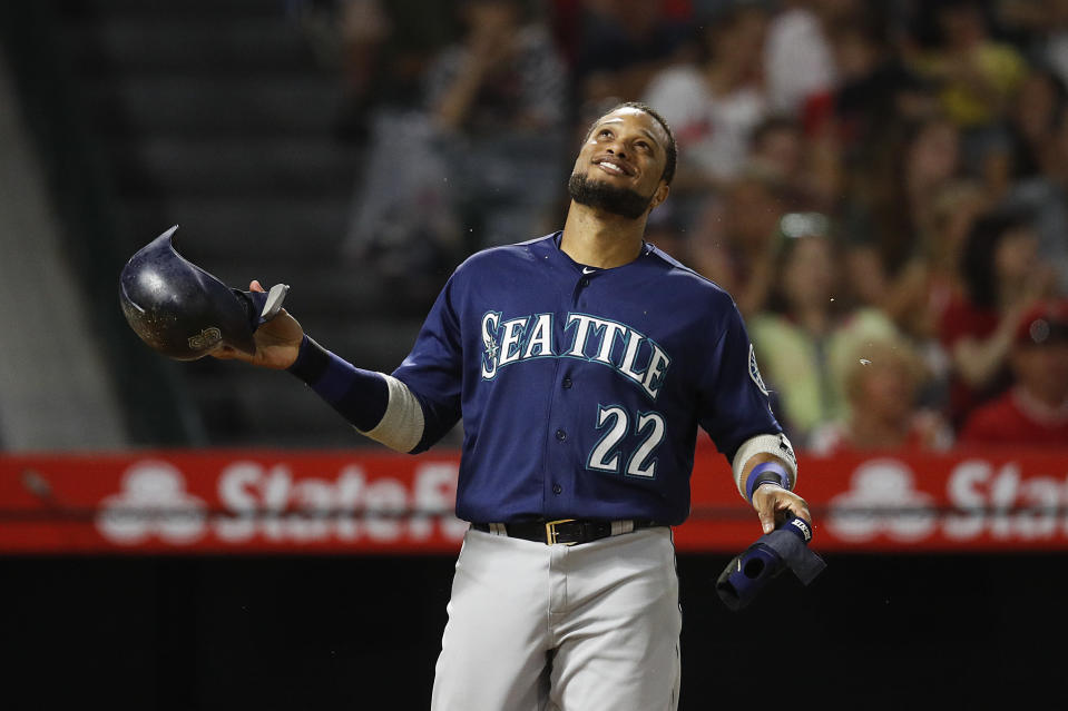 Seattle Mariners' Robinson Cano smiles after the top of the eighth inning of a baseball game against the Los Angeles Angels, Saturday, Sept. 15, 2018, in Anaheim, Calif. Cano hit a three-run double in the eighth inning. (AP Photo/Jae C. Hong)