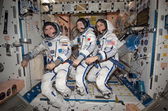n the International Space Station's Unity node, NASA astronaut Sunita Williams, Expedition 33 commander; along with Japan Aerospace Exploration Agency astronaut Aki Hoshide (center) and Russian cosmonaut Yuri Malenchenko (left), both flight eng