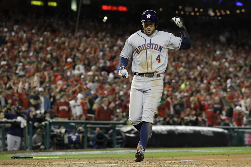 Houston Astros' George Springer celebrates after scoring on a dingle by Yuli Gurriel during the eighth inning of Game 5 of the baseball World Series against the Washington Nationals Sunday, Oct. 27, 2019, in Washington. (AP Photo/Jeff Roberson)