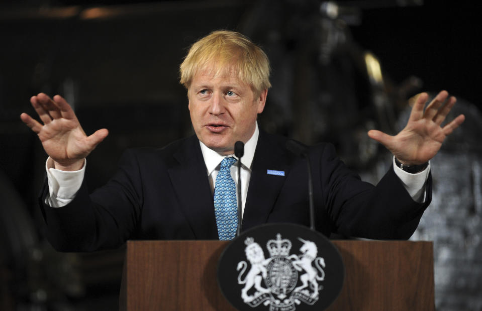 """Britain's Prime Minister Boris Johnson gestures as he gives a speech on domestic priorities at the Science and Industry Museum in Manchester, northwest England on July 27, 2019. - British Prime Minister Boris Johnson on Saturday said Brexit was a """"massive economic opportunity"""" but had been treated under his predecessor Theresa May as """"an impending adverse weather event"""". (Photo by Rui Vieira / various sources / AFP)        (Photo credit should read RUI VIEIRA/AFP/Getty Images)"""