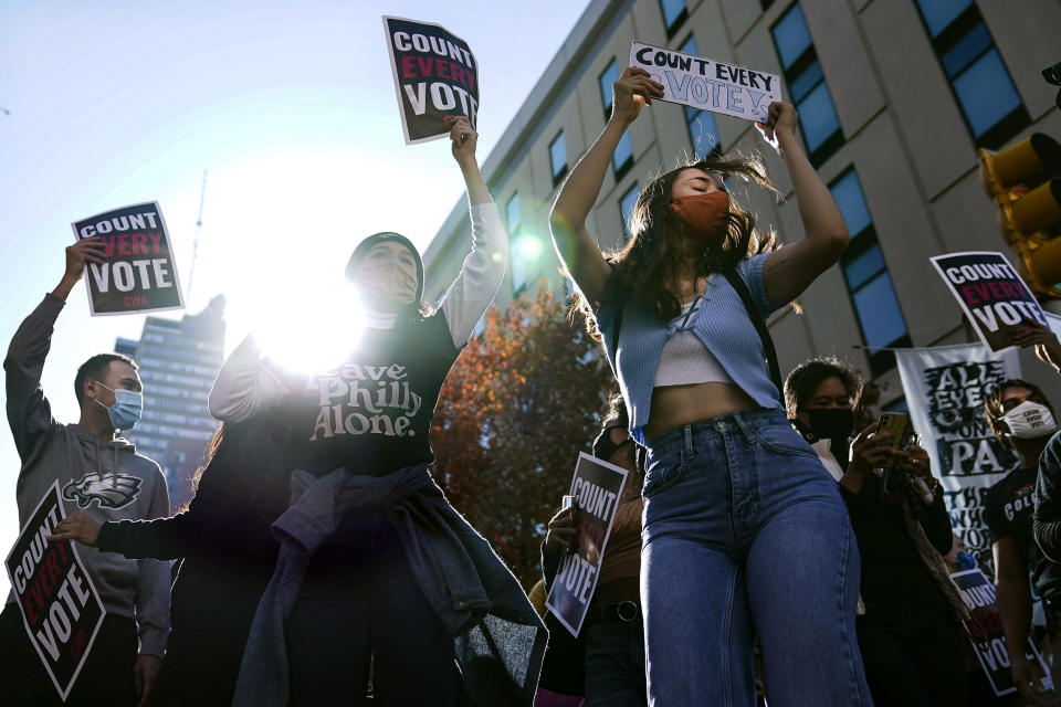 Demonstrators urging all votes be counted gather outside the Pennsylvania Convention Center where votes are being counted, Friday, Nov. 6, 2020, in Philadelphia. (AP Photo/John Minchillo)