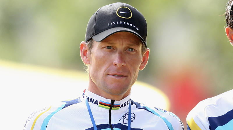 Cyclist Lance Armstrong during the Tour de France stares forward on the podium.