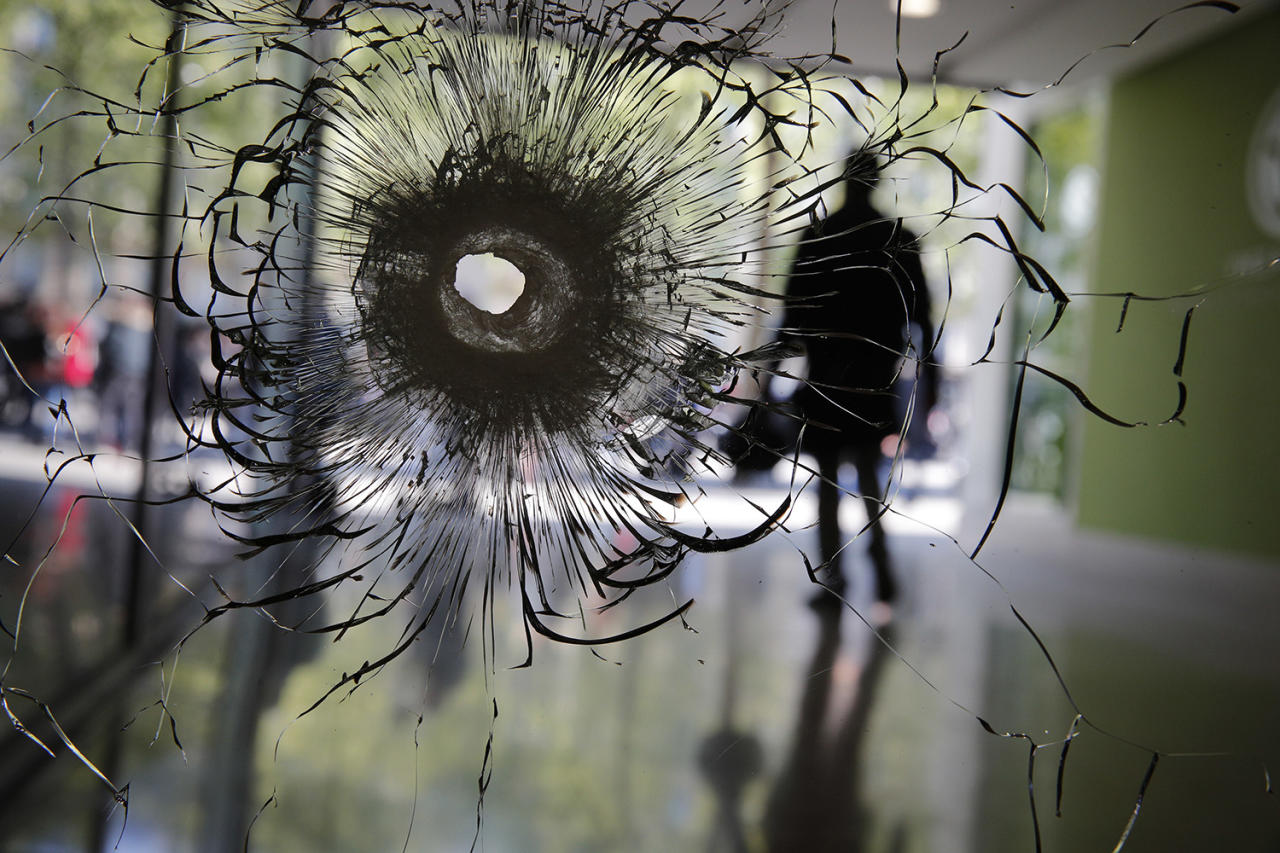 <p>A bullet hole is pictured on a shopwindow of the Champs Elysees boulevard in Paris, Friday, April 21, 2017. France began picking itself up Friday from another deadly shooting claimed by the Islamic State group, with President Francois Hollande convening the government's security council and his would-be successors in the presidential election campaign treading carefully before voting this weekend. (Photo: Christophe Ena/AP) </p>