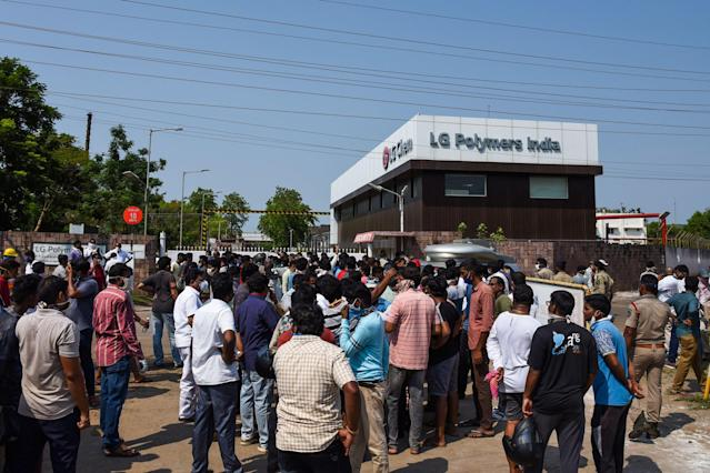 People gather in front of an LG Polymers plant following a gas leak incident in Visakhapatnam on May 7, 2020. - At least seven people were killed and hundreds hospitalised after a pre-dawn gas leak at a chemical plant in eastern India on May 7 that left unconscious victims lying in the streets, authorities said. The gas escaped out of tanks at a complex owned by South Korea's LG Chem that had suspended operations because of India's coronavirus lockdown. (Photo by - / AFP) (Photo by -/AFP via Getty Images)