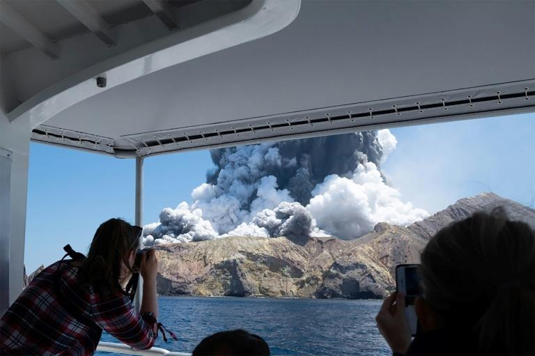 A photo courtesy of Michael Schade shows the volcano on New Zealand's White Island spewing steam and ash moments after it erupted