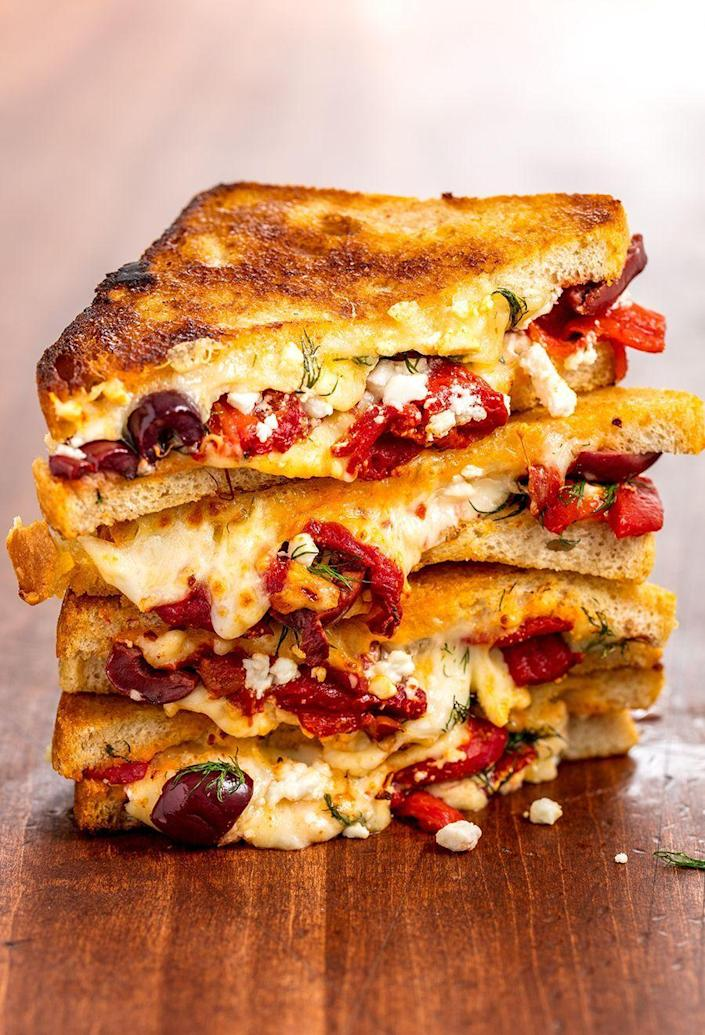 """<p>Filled with olives and fresh herbs, this grilled cheese is different than anything you've tried.</p><p><em><strong>Get the recipe at <a href=""""https://www.delish.com/cooking/a22993345/greek-grilled-cheese/"""" rel=""""nofollow noopener"""" target=""""_blank"""" data-ylk=""""slk:Delish."""" class=""""link rapid-noclick-resp"""">Delish.</a></strong></em></p>"""
