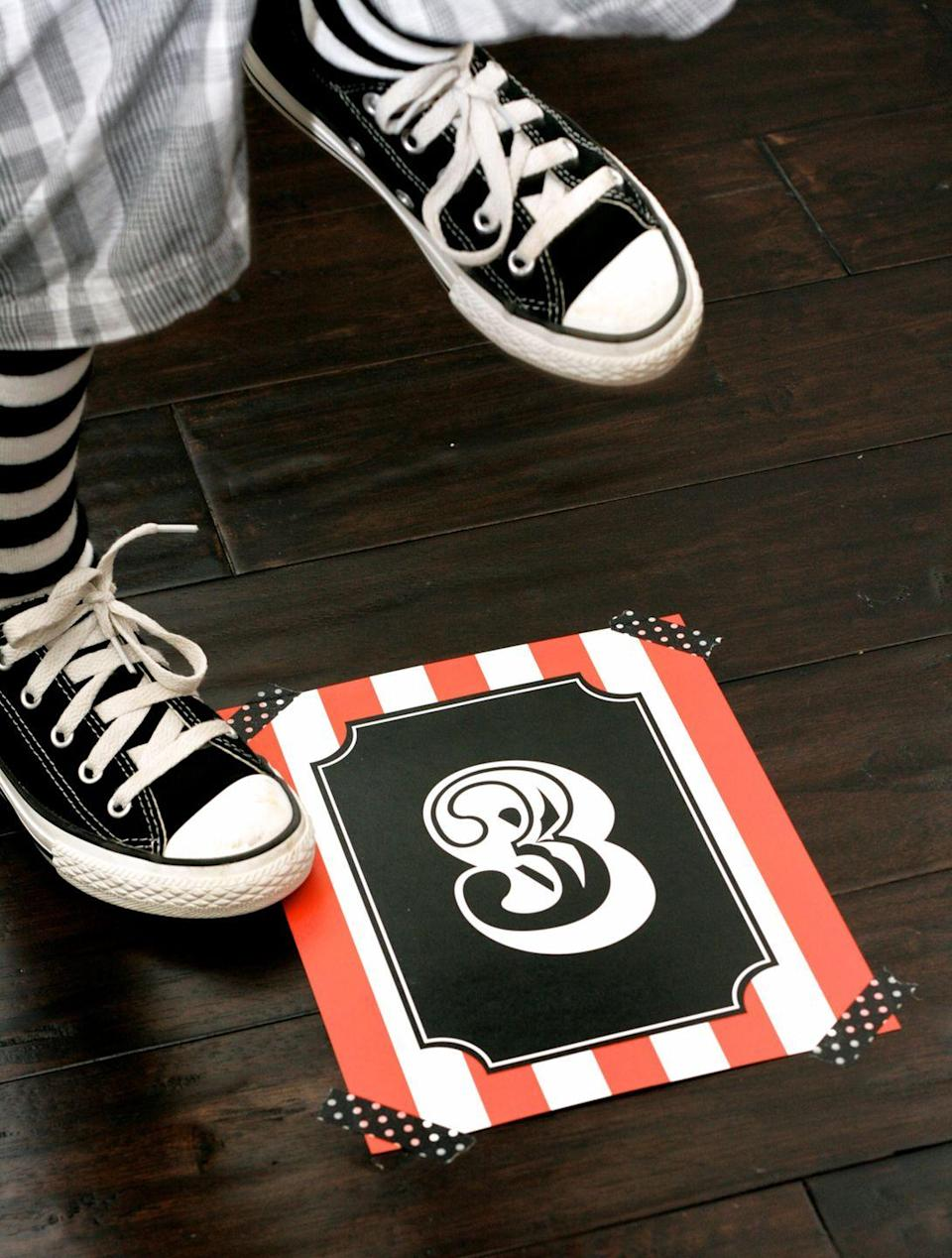 """<p>Think of this fun cakewalk game as similar to musical chairs. Kids walk around a circle of numbers on the floor — then stop on a number when the music stops. Whoever's standing on the number that's drawn from a tin wins!</p><p><em><a href=""""https://seevanessacraft.com/2016/09/halloween-cakewalk-party-printables/"""" rel=""""nofollow noopener"""" target=""""_blank"""" data-ylk=""""slk:Get a free printable at See Vanessa Craft »"""" class=""""link rapid-noclick-resp"""">Get a free printable at See Vanessa Craft »</a></em></p><p><strong>RELATED:</strong> <a href=""""https://www.goodhousekeeping.com/holidays/halloween-ideas/g33264944/halloween-printables/"""" rel=""""nofollow noopener"""" target=""""_blank"""" data-ylk=""""slk:15 Free Halloween Printables for Fun Decor, Games, Treats, and More"""" class=""""link rapid-noclick-resp"""">15 Free Halloween Printables for Fun Decor, Games, Treats, and More</a><br></p>"""