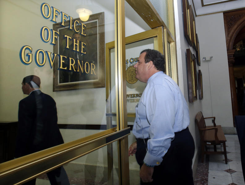 New Jersey Gov. Chris Christie walks into his office as he returns to work at the Statehouse in Trenton, N.J., Thursday, Nov. 7, 2013, after his re-election victory over Democratic challenger Barbara Buono on Nov. 5. (AP Photo/Mel Evans)