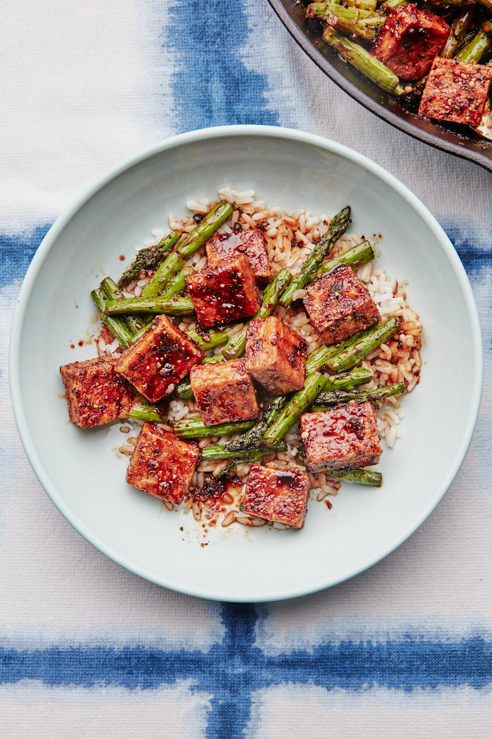 "In this 30-minute dish, which is inspired by Yotam Ottolenghi's recipe in his 2011 book <em>Plenty</em>, black pepper is the star, <em>not</em> the sidekick: When bloomed in oil, the coarsely ground peppercorns become piquant and fragrant enough to flavor the entire sauce, no red pepper flakes, dried chiles, or hot sauce needed. Take care not to burn the peppercorns as you toast them or the flavor could swing from spicy to bitter. <a href=""https://www.bonappetit.com/recipe/black-pepper-tofu-and-asparagus?mbid=synd_yahoo_rss"" rel=""nofollow noopener"" target=""_blank"" data-ylk=""slk:See recipe."" class=""link rapid-noclick-resp"">See recipe.</a>"