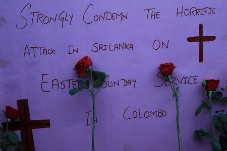 A sign and roses placed for the victims of Sri Lanka's serial bomb blasts, are displayed outside a church in Peshawar, Pakistan April 21, 2019. REUTERS/Fayaz Aziz