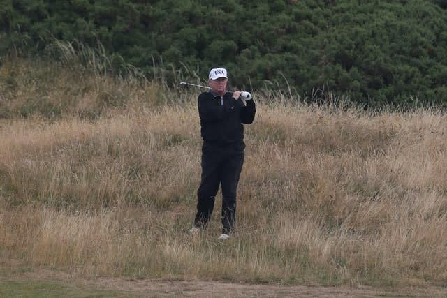 US President Donald Trump, who was alleged in a 2019 book to habitually cheat at golf (Andrew Milligan/PA)