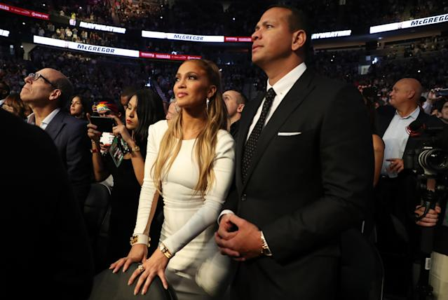 <p>Actress Jennifer Lopez and former MLB player Alex Rodriguez attend the super welterweight boxing match between Floyd Mayweather Jr. and Conor McGregor on August 26, 2017 at T-Mobile Arena in Las Vegas, Nevada. (Photo by Christian Petersen/Getty Images) </p>