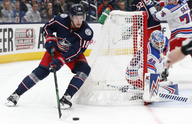 Columbus Blue Jackets' Pierre-Luc Dubois, left, tries to take a shot against New York Rangers' Alexandar Georgiev during the second period of an NHL hockey game Thursday, Dec. 5, 2019, in Columbus, Ohio. (AP Photo/Jay LaPrete)